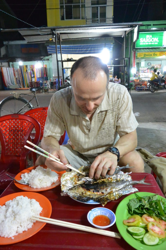 Tomasz Chrusciel enjoying fish for dinner in Ho Chi Minh City, Vietnam